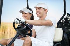 Szczęśliwa golfowa para Obrazy Royalty Free