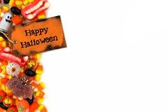 Szczęśliwa Halloweenowa etykietka z cukierek strony granicą nad bielem Fotografia Royalty Free