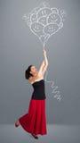 Szczęśliwa kobieta trzyma uśmiechać się balonów rysować Fotografia Stock