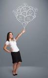 Szczęśliwa kobieta trzyma uśmiecha się balonów rysować Zdjęcie Stock
