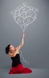 Szczęśliwa kobieta trzyma uśmiecha się balonów rysować Fotografia Royalty Free