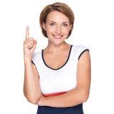 Szczęśliwa kobieta wskazuje up z jej palcem Obrazy Royalty Free