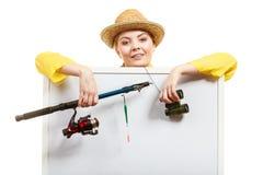 Szczęśliwa kobieta z połowu prącia mienia deską fotografia royalty free