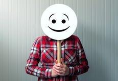 Szczęśliwa kobieta z smiley emoticon Fotografia Royalty Free