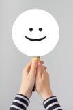 Szczęśliwa kobieta z smiley emoticon Obraz Stock