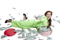 Szczęśliwa kobieta z stosem dolary fotografia royalty free