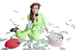 Szczęśliwa kobieta z stosem dolary zdjęcia stock