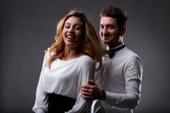 Szczęśliwa mądrze para w partyjnej sukni Obrazy Royalty Free