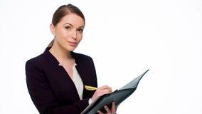 Szczęśliwa Młoda Biznesowa kobieta Robi notatkom zdjęcie wideo