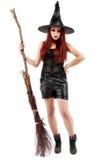 szczęśliwa młoda czarownica z miotłą Fotografia Royalty Free
