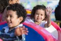 Szczęśliwa młoda dziewczyna przy parkiem rozrywki Obrazy Royalty Free