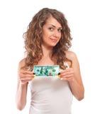Szczęśliwa młoda kobieta trzyma up sto dolarów Obrazy Stock