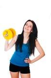 Szczęśliwa młoda kobieta z dumbbell zdjęcie stock