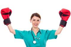 Szczęśliwa młoda kobiety lekarka, pielęgniarka jest ubranym bokserskie rękawiczki lub Obraz Royalty Free