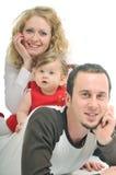 Szczęśliwa młoda rodzina Zdjęcie Royalty Free