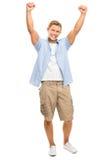 Szczęśliwa młody człowiek odświętność z rękami up odizolowywać na białym backg Fotografia Royalty Free