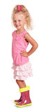 Szczęśliwa mała blond dziewczyna w bluzki spódnicy gumowych butach odizolowywających Obrazy Royalty Free