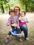 Szczęśliwa matka z dwa dziećmi Obrazy Royalty Free