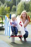 Szczęśliwa matka z dwa roczniaka synem na boisku Obrazy Royalty Free