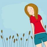Szczęśliwa nastoletnia dziewczyna patrzeje w dół przy kamerą i ono uśmiecha się, niebieskie niebo za ona, stoi przed kukurydzanym royalty ilustracja