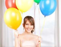 Szczęśliwa nastoletnia dziewczyna z balonami Obrazy Stock