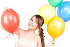 Szczęśliwa nastoletnia dziewczyna z balonami Fotografia Royalty Free