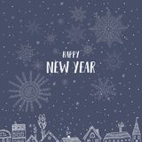 Szczęśliwa nowy rok karta z domami w mieście Fotografia Royalty Free