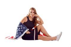Szczęśliwa patriotyczna kobiety mienia usa flaga Obraz Stock