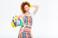 Szczęśliwa piękna kobiety pozycja, mienie i boksujemy z cleansers Zdjęcia Stock