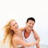 szczęśliwa plażowa para Zdjęcie Stock