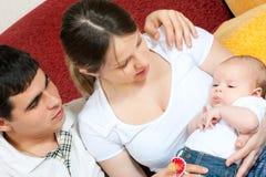 Szczęśliwa rodzina - matka ojciec i dziecko, zdjęcia stock
