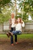 Szczęśliwa rodzina przed domem outdoors Obraz Royalty Free