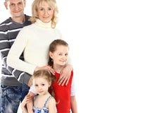 Szczęśliwa rodzina z dwa dziećmi zdjęcia royalty free