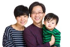 Szczęśliwa rodzina z dziecko synem fotografia stock
