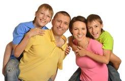 Szczęśliwa rodzina z młodymi dziećmi na białym tle Obraz Royalty Free