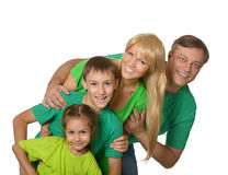 Szczęśliwa rodzina z młodymi dziećmi na białym tle Obrazy Royalty Free