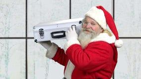 Szczęśliwa Santa mienia skrzynka pieniądze pełno zbiory