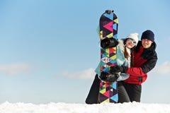 Szczęśliwa sportsmenka z snowboard zdjęcie royalty free