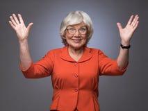 Szczęśliwa starsza dama z rękami up Obrazy Royalty Free