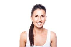 Szczęśliwa uśmiechnięta dziewczyna na bielu Obrazy Stock