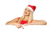 Szczęśliwa uśmiechnięta kobieta z białą puste miejsce deską obraz royalty free