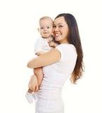 Szczęśliwa uśmiechnięta matka z dzieckiem na bielu obraz royalty free