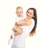 Szczęśliwa uśmiechnięta matka z dzieckiem na bielu obrazy royalty free