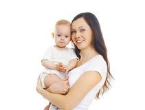 Szczęśliwa uśmiechnięta matka z dzieckiem nad bielem obraz stock