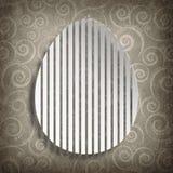 Szczęśliwa wielkanoc - kształt jajko na wzorzystym tle Obrazy Stock