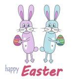 Szczęśliwa wielkanoc! Wielkanocni króliki i jajka, biały tło Colorfu Obrazy Royalty Free