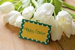 Szczęśliwa Wielkanocna karta i tulipany Fotografia Royalty Free