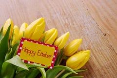 Szczęśliwa Wielkanocna karta i tulipany Zdjęcie Royalty Free
