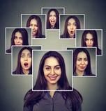 Szczęśliwa zamaskowana kobieta wyraża różne emocje zdjęcie royalty free