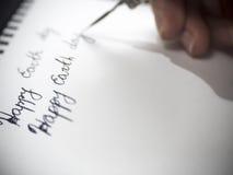 Szczęśliwa ziemskiego dnia kaligrafia i lattering Obraz Royalty Free
